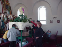 The woman of the church decorate the tomb.