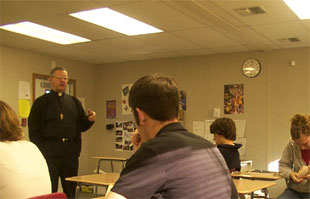 Father Andrew speaks to the class.
