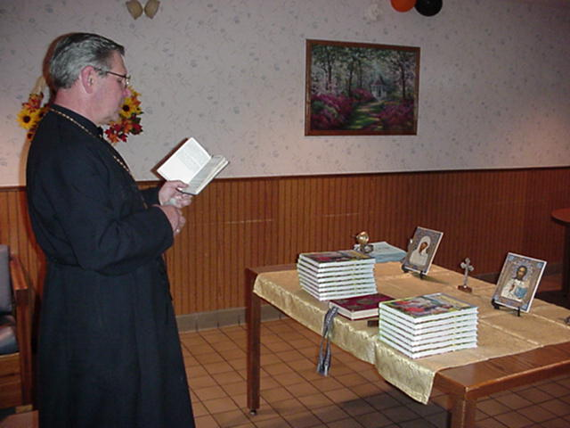 Father Andrew performing the service.