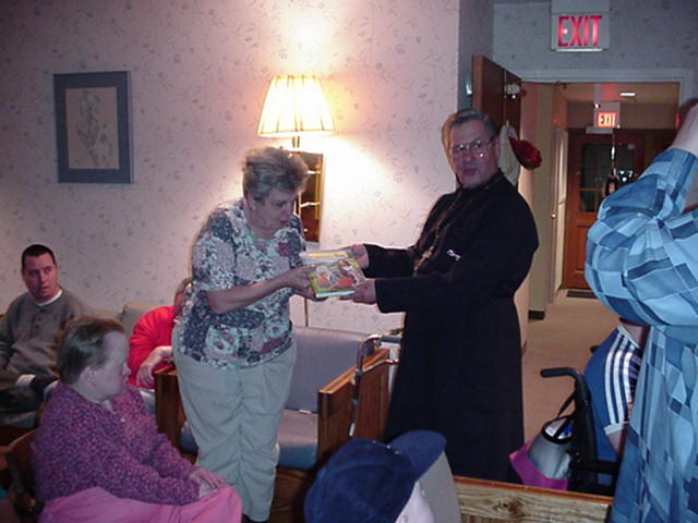 Gifts are presented to the residents.