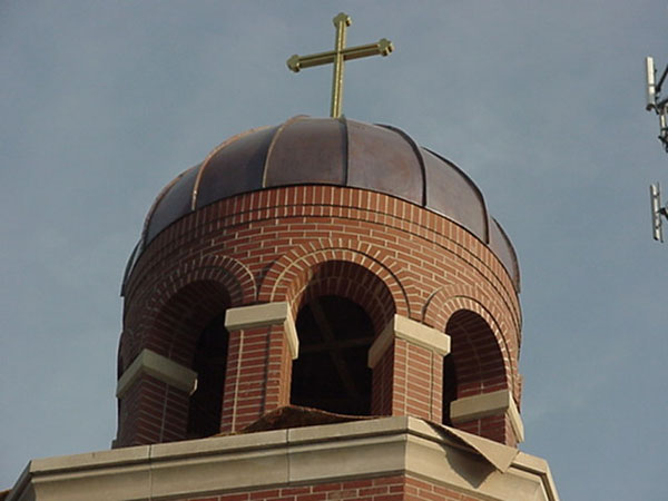 Cross placed on top of bell tower