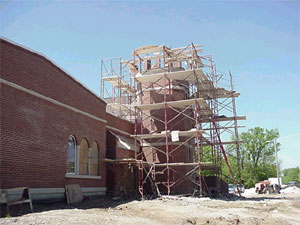 Work continues on top of bell tower.