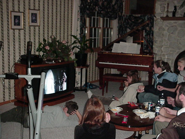 The youth watch the movie, Monty Python and the Holy Grail.