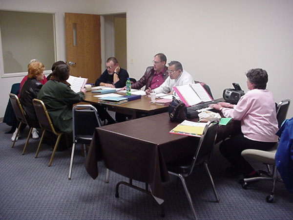 The choir members practiced in the new conference room.