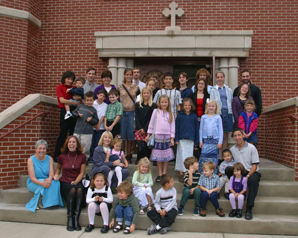The Church School gathered on stairs for a picture.