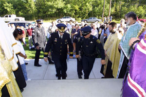 Honor guard brings memorial to St. Luke.