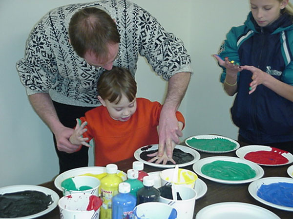 Children get into painting.