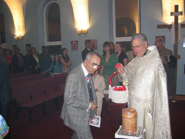 Parishioners receive red egg.