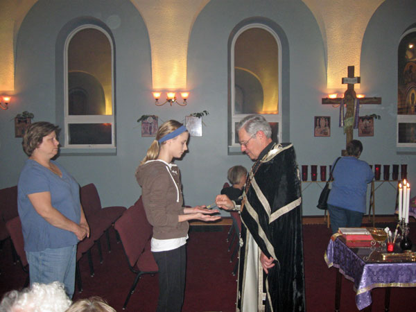 Father Andrew anoints parishioner with the Oil of Holy Unction .