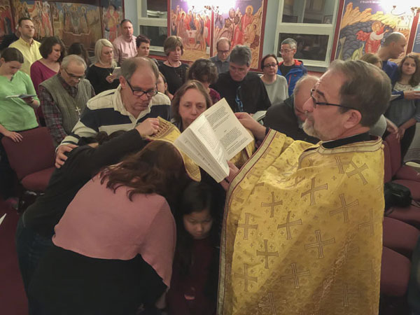 Parishioners receive prayers of special healing .