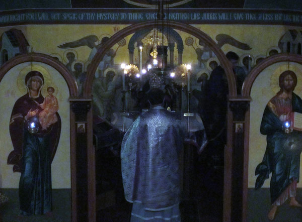 Parishioners prostrate before the Light Of Christ.