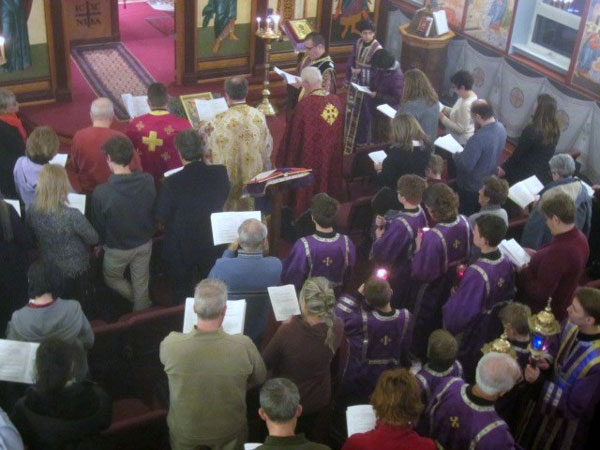 Clergy pray over Holy Oil .