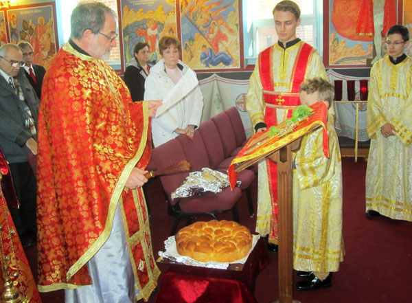 Scene from Liturgy Of St. Basil and St. Basil's Bread (Vasilopita).